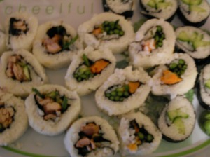 Cheelful sushi! Loose and kind of crappy-looking sushi rolls on my favourite platter ever.