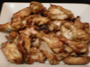 A blurry photo of some saucy wings.