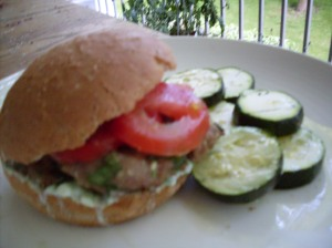 Lamb burger with grilled zucchini.