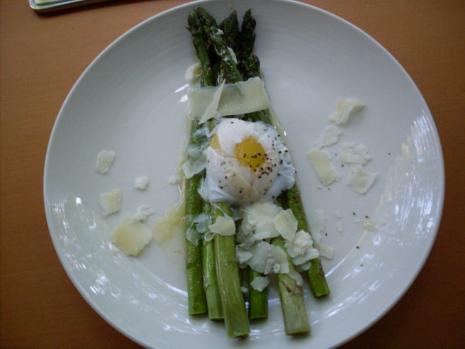 Asparagus in garlic butter, topped with an egg poached in dry white wine, and shaved parmesan.