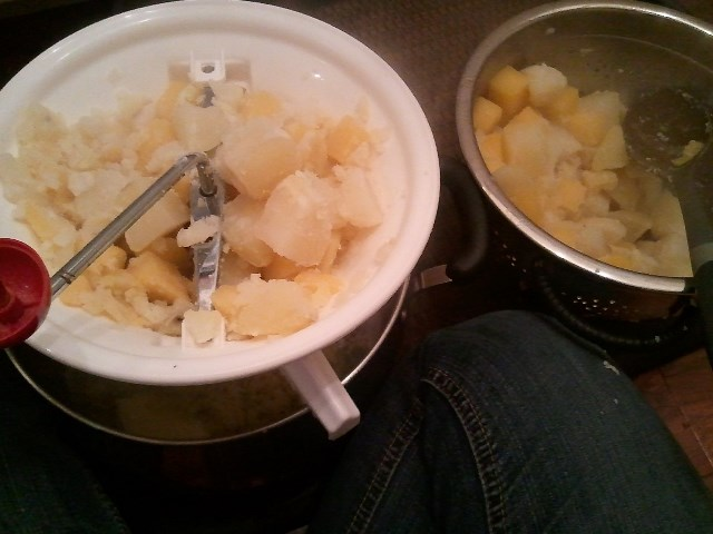 Sitting on the floor, milling some turnips and potatoes.