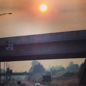 Smoke over the highway. Weird red sun.